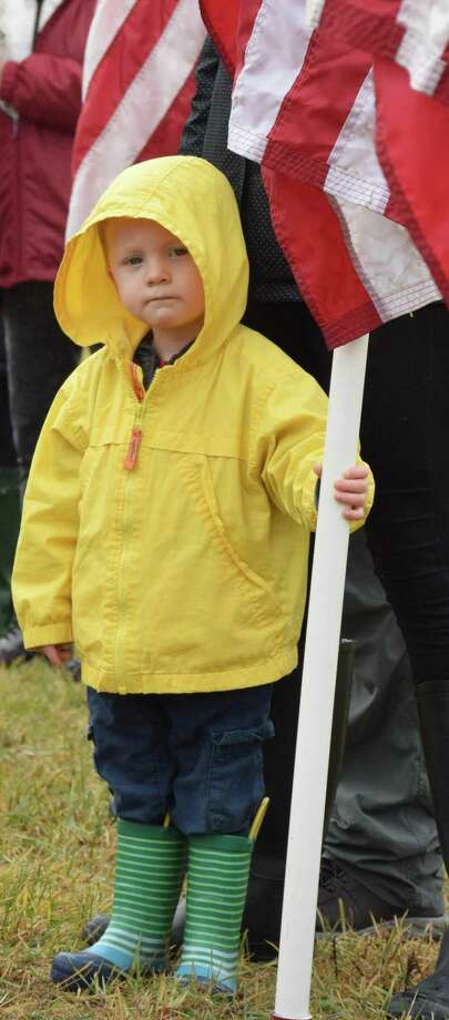 At right, Liam Scott, 2, of Bridgewater proudly helps hold a flag during the ceremony. Photo: Deborah Rose / Hearst Connecticut Media / The News-Times  / Spectrum