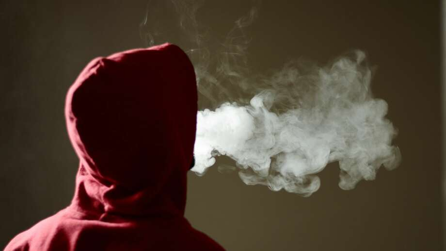 Stock image of a person vaping with an e-cigarette. Photo: Property Of Naveen Asaithambi / Getty Images