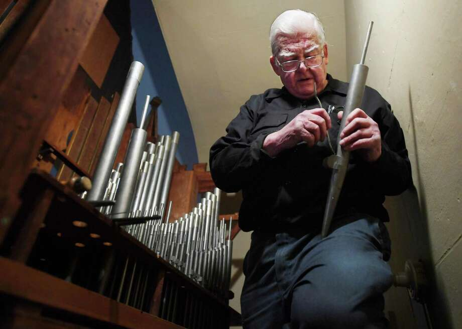 Richard Hamar, of Norwich, reconstructs and tunes the 1849 vintage pipe organ at Christ Episcopal Church Tashua in Trumbull, Conn. on Tuesday, December 17, 2018. The organ, damaged by a summer ceiling collapse, is on schedule to be back in operation for Christmas eve services. Photo: Brian A. Pounds / Hearst Connecticut Media / Connecticut Post