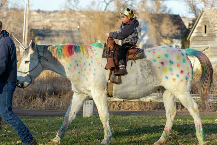 Wyatt Haas, 5, of Montana rides a horse decorated to look like a unicorn. Photo: Courtesy Of Tamara Choat. / Handout
