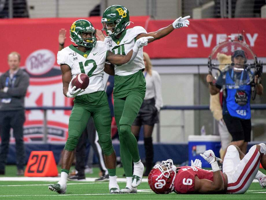 Baylor wide receiver Chris Platt (12) celebrates a long reception with wide receiver Tyquan Thornton (81) as Oklahoma cornerback Tre Brown (6) lies on the turf during the second half of an NCAA college football game for the Big 12 Conference championship, Saturday, Dec. 7, 2019, in Arlington, Texas. Oklahoma won 30-23. (AP Photo/Jeffrey McWhorter) Photo: Jeffrey McWhorter, FRE / Associated Press / Copyright 2018 The Associated Press. All rights reserved