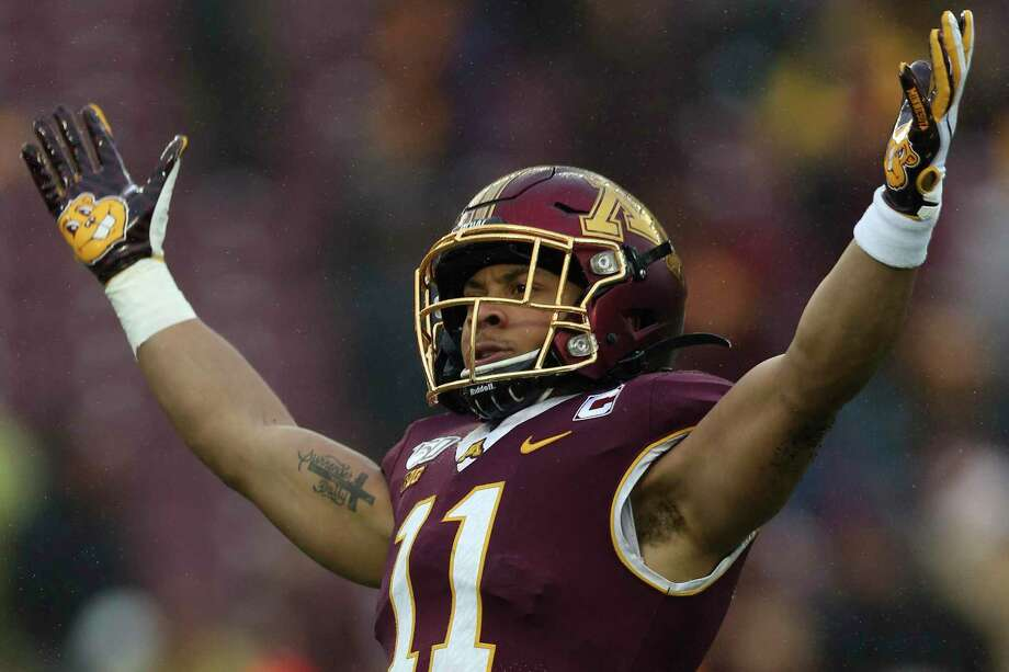 In this Nov. 30, 2019, file photo. Minnesota defensive back Antoine Winfield Jr. (11) gestures during an NCAA college football game against Wisconsin, in Minneapolis. Winfield was selected to The Associated Press All-America team, Monday, Dec. 16, 2019. Photo: Stacy Bengs, FRE / Associated Press / Copyright 2019 The Associated Press. All rights reserved.