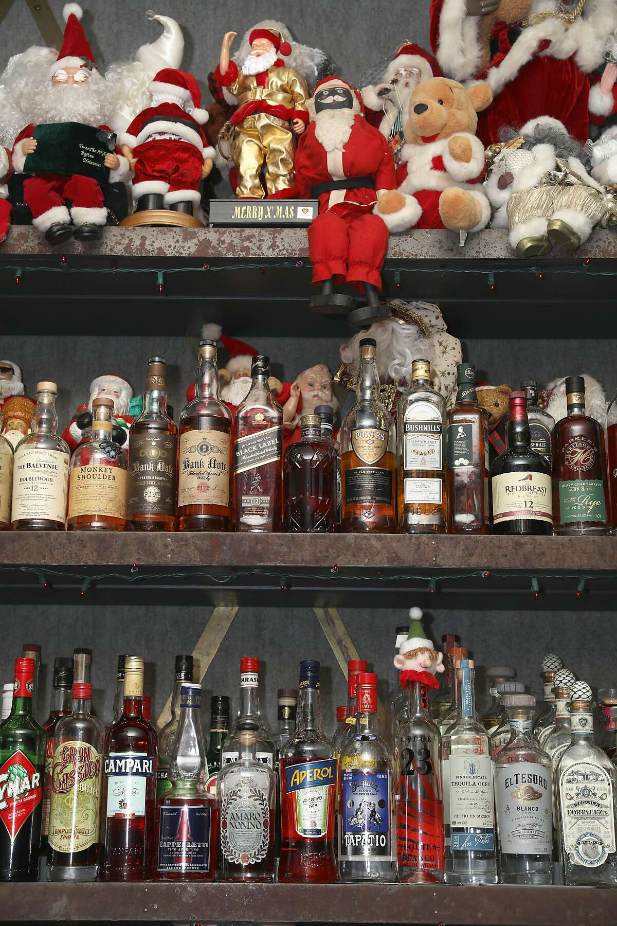 Famous drag queen Marlena who used to own this bar now named Brass Tacks in Hayes Valley talks about the Santas and Christmas decor surrounding the liquor bottles which she�s collected on Monday, Dec. 9, 2019, in San Francisco, Calif.