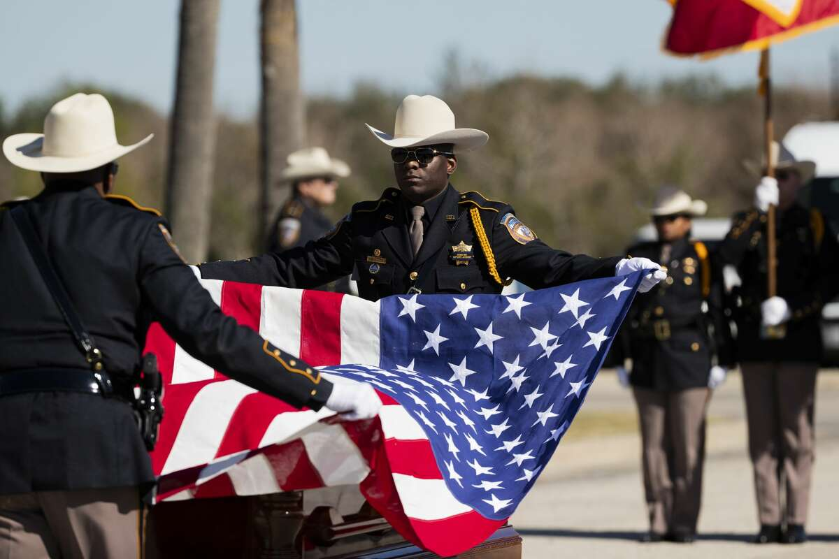 Members of the Harris County Sheriff's Office Honor Guard lift the United States flag from the casket of Nassau Bay Police Department Sgt. Kaila Sullivan during a ceremony at Grace Community Church on Wednesday, Dec. 18, 2019, in Houston.