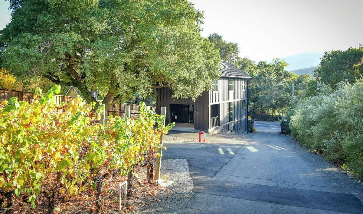 The St. Helena listing includes a two-bedroom, two-and-a-half bathroom artist barn built in 2018.