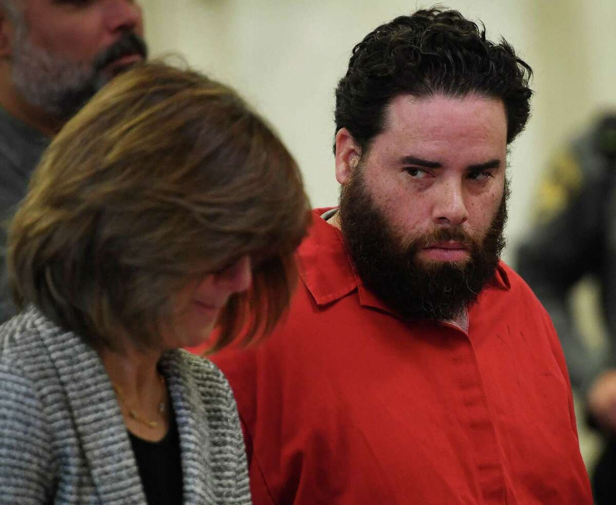 Jose Morales looks over at his lawyer, Assistant Public Defender Margaret Moreau, during a pretrial appearance on felony weapons charges in Superior Court in New Haven, Conn. on Wednesday, December 18, 2019. Morales is the main suspect in the murder of his girlfriend Christine Holloway, of Ansonia. Morales and Holloway's baby, Vanessa Morales, has been missing since the murder.