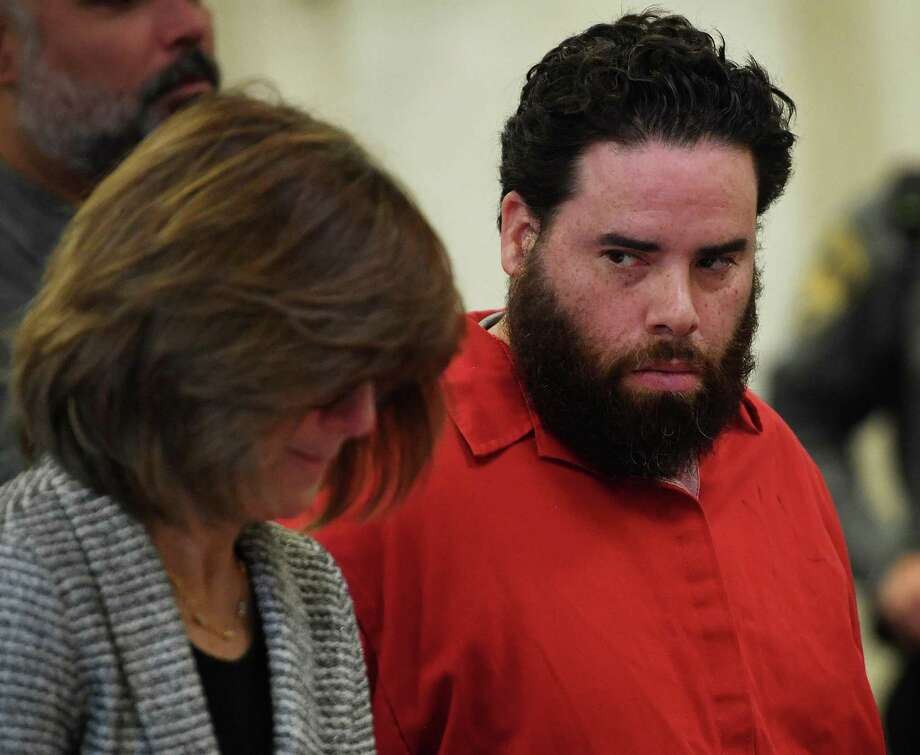 Jose Morales looks over at his lawyer, Assistant Public Defender Margaret Moreau, during a pretrial appearance on felony weapons charges in Superior Court in New Haven, Conn. on Wednesday, December 18, 2019. Morales is the main suspect in the murder of his girlfriend Christine Holloway, of Ansonia. Morales and Holloway's baby, Vanessa Morales, has been missing since the murder. Photo: Brian A. Pounds / Hearst Connecticut Media / Connecticut Post