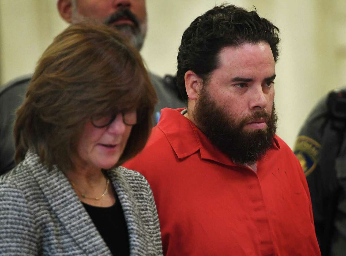 Jose Morales appears with his lawyer, Assistant Public Defender Margaret Moreau, during a pretrial hearing on felony weapons charges in Superior Court in New Haven, Conn. on Wednesday, December 18, 2019. Morales is the main suspect in the murder of his girlfriend Christine Holloway, of Ansonia. Police believe he may be involved in the disappearance of their daughter, Vanessa.