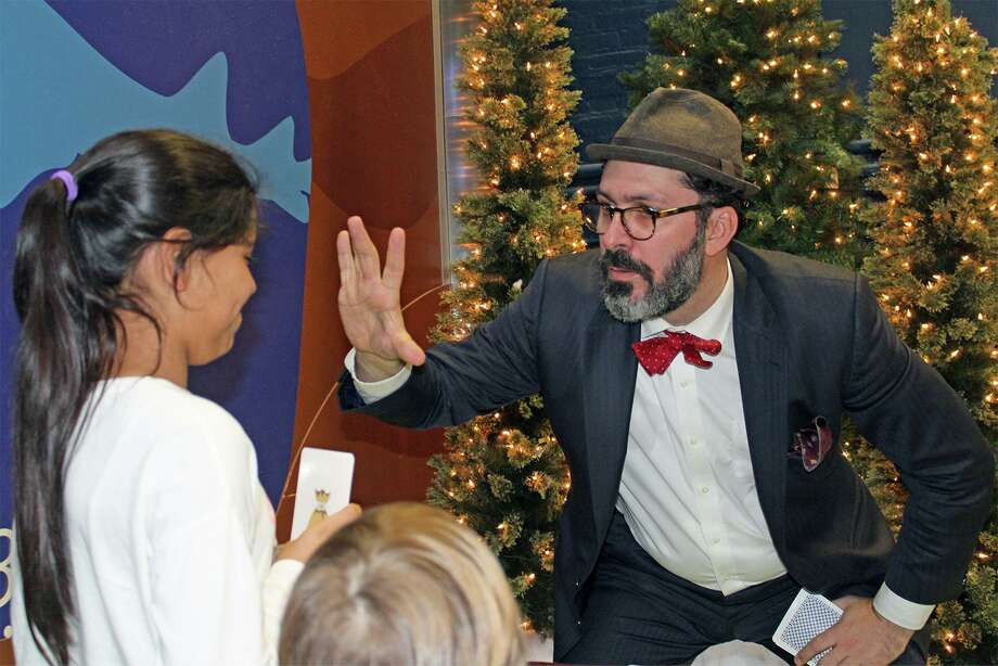 """Street magician Greg Dubin will entertain guests with his sleight-of-hand tricks between 10 a.m. and 2 p.m. during """"Noon Year's Eve"""" at The Maritime Aquarium at Norwalk on Dec. 31. Photo: Maritime Aquarium / Contributed Photo"""