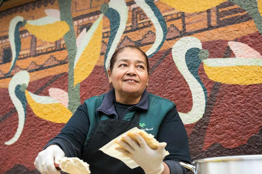 La Palma Mexicatessen has been a permanent fixture in the Mission District since 1953. For the last 10 years, Teresa Rodriguez has been the driving force behind the handmade tamales she makes during the Christmas holiday season. Photo: Blair Heagerty / SFGate