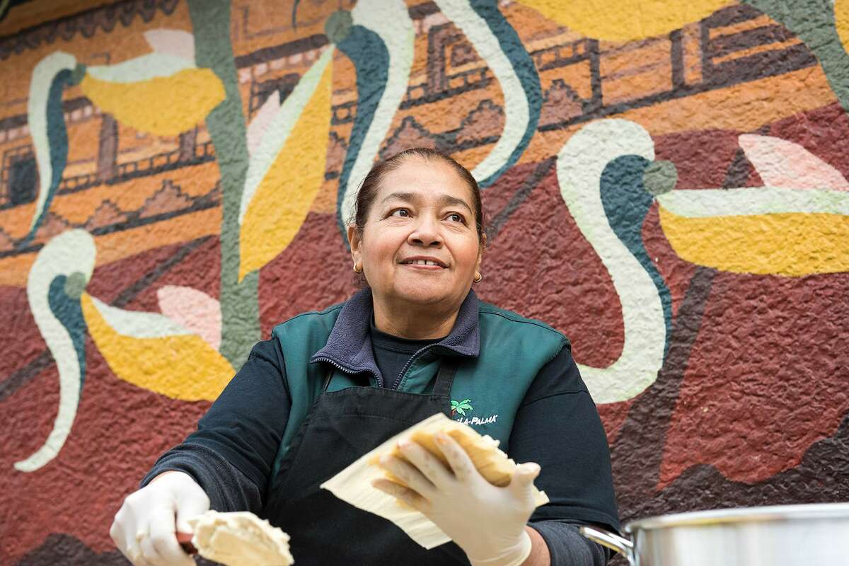 La Palma Mexicatessen has been a permanent fixture in the Mission District since 1953. For the past 10 years, Teresa Rodriguez, who is pictured in this December 2019 photo, has been the driving force behind the handmade tamales during the Christmas holiday season.