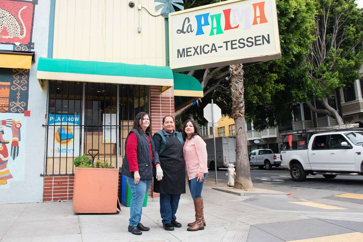 La Palma Mexicatessen has been a permanent fixture in the Mission District since 1953. For the past 10 years, Teresa Rodriguez has been the driving force behind the handmade tamales for the Christmas holiday season. Pictured from left to right are co-owner Aida Ibarra, Doña Tere and Theresa Pasion.
