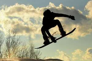 Jordan Myers of Lansingburgh hones his snowboarding skills on a hill in Frear Park in Troy, N.Y. (Lori Van Buren/Times Union)