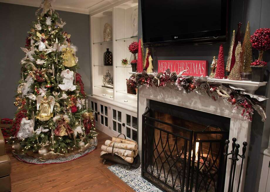 The owners of this Ridgefield home begin decorating for the holidays over Thanksgiving weekend. 'Christmas starts with the tree. It's a joint family event and tradition, and I love it,' says the homeowner. Photo: Bryan Haeffele / Hearst Connecticut Media / BryanHaeffele