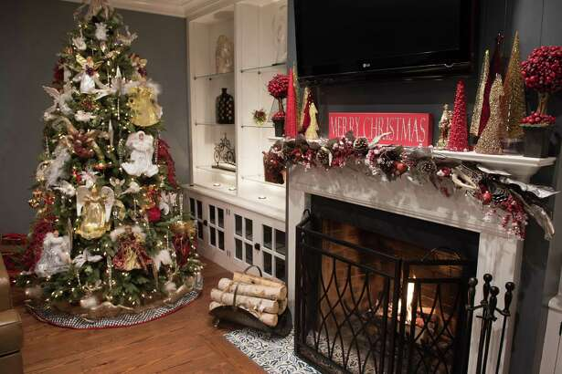The owners of this Ridgefield home begin decorating for the holidays over Thanksgiving weekend. 'Christmas starts with the tree. It's a joint family event and tradition, and I love it,' says the homeowner.