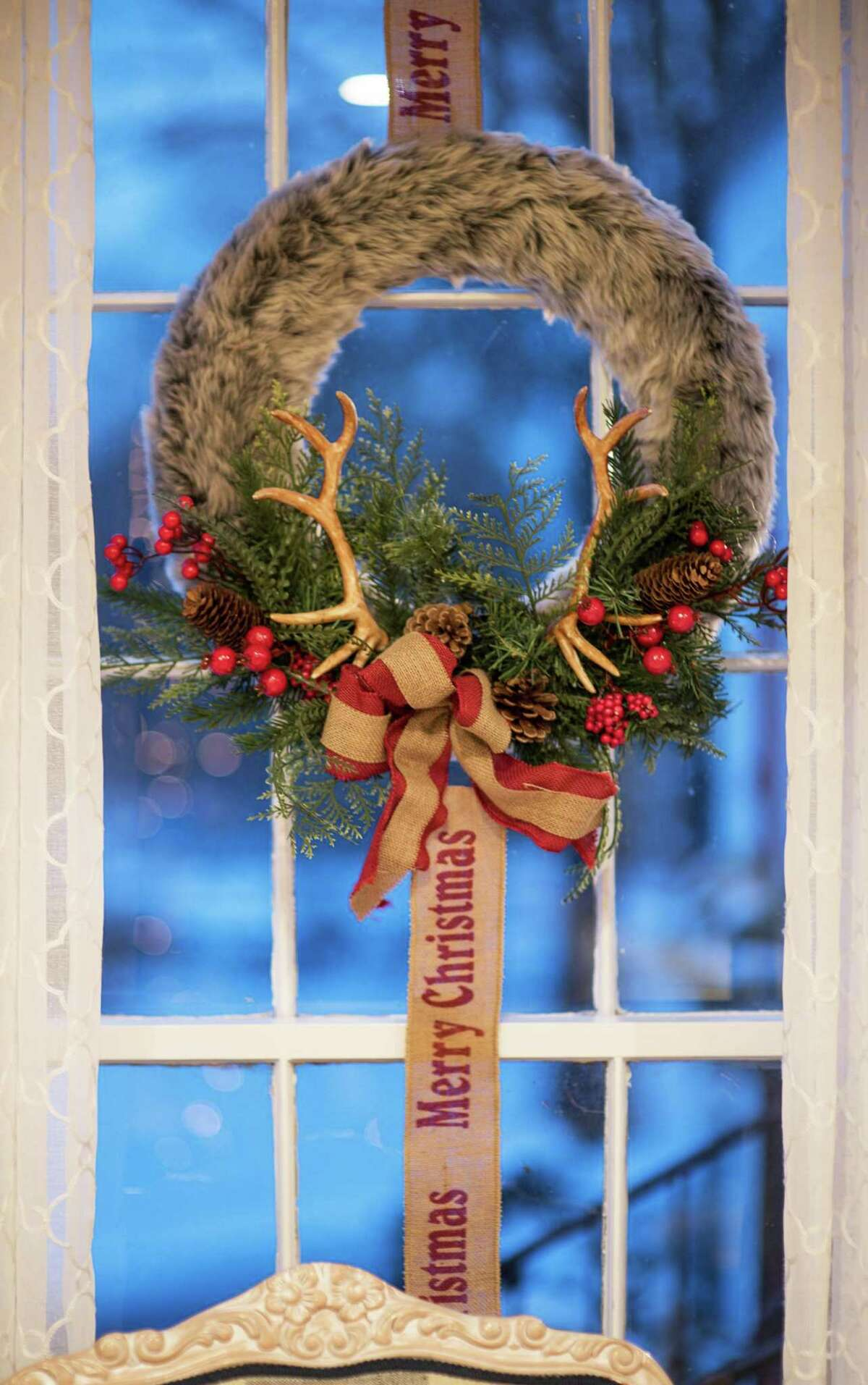 A festive wreath is just one of the many holiday touches in this home.