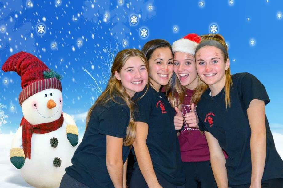 A quartet of  Christmas elves at Santa's Workshop. Photo: Henry Groeper / Contributed Photo