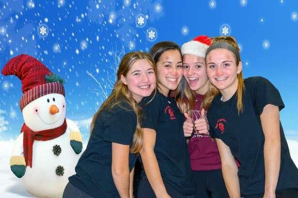 A quartet of Christmas elves at Santa's Workshop.