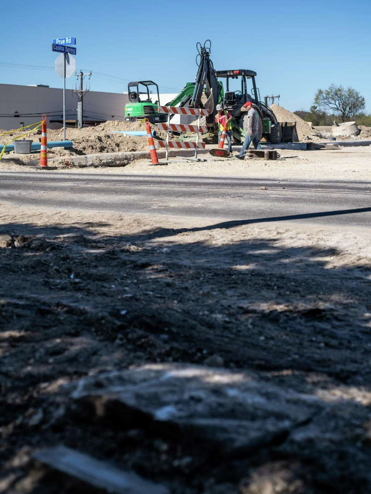 A construction crew works across the street from the Oak Hollow Pet Memorial Park in the 6300 block of Prue Road on San Antonio's Northwest Side on Friday, Dec. 6, 2019. Several people who have animals buried at the cemetery said workers disturbed the graves during their construction project.