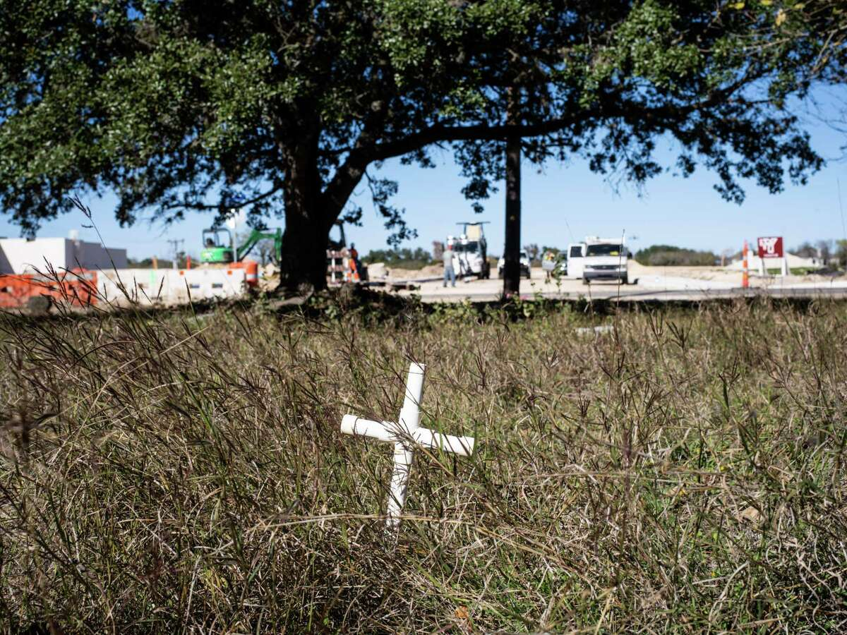 A cross is seen in an overgrown area at the Oak Hollow Pet Memorial Park on San Antonio's Northwest Side on Friday, Dec. 6, 2019.