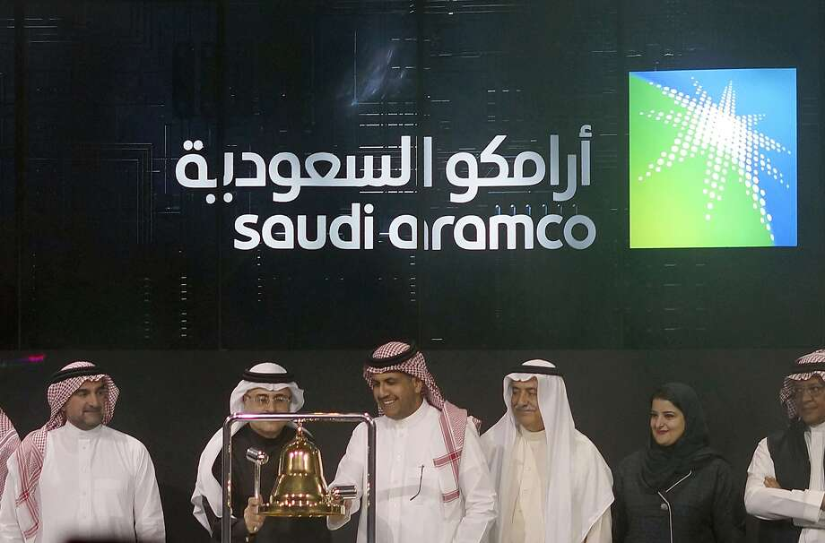 FILE - In Dec. 11, 2019, file photo Saudi Arabia's state-owned oil company Armco and stock market officials celebrate during the official ceremony marking the debut of Aramco's initial public offering (IPO) on the Riyadh's stock market, in Riyadh, Saudi Arabia. Saudi Aramco became the world's most valuable public company this year with a highly anticipated stock offering in December. (AP Photo/Amr Nabil, File) Photo: Amr Nabil, Associated Press