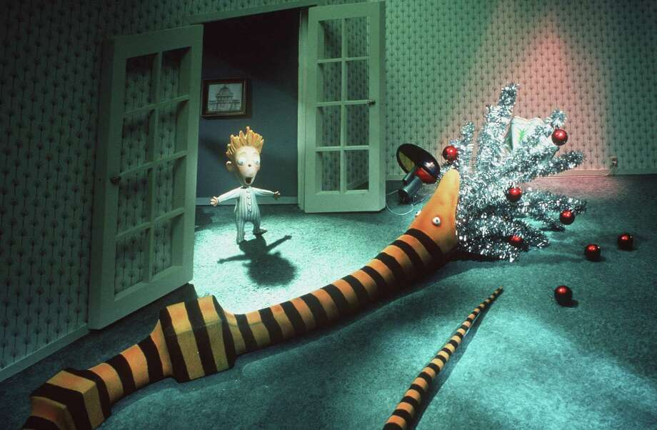 """A young boy is astonished to see one of Santa's gifts, an over-sized snake, devour the family Christmas tree in Touchstone Pictures animated film """"Tim Burton's A Nightmare Before Christmas,"""" which will be screened at Cos Cob Library Dec. 23. Photo: Joel Fletcher / Online USA / Getty Images / Hulton Archive"""