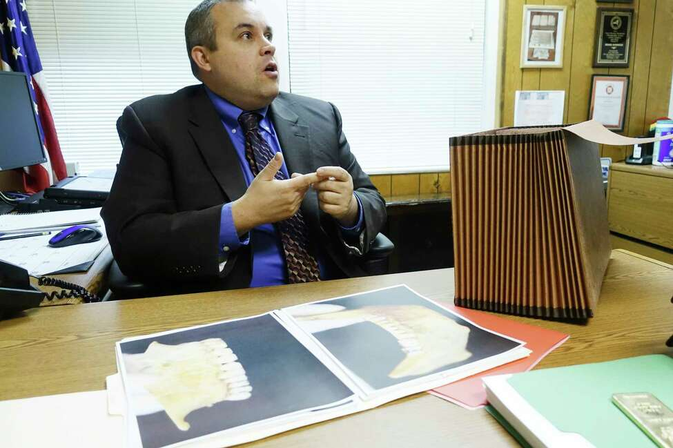 Bethlehem Police Commander Adam Hornick shows items from a case file pertaining to the finding of human remains back in 1981, during an interview on Wednesday, Dec. 18, 2019, in Bethlehem, N.Y. The partially decomposed remains of the adult male were discovered in a wooded area adjacent to the rear of the Elm Avenue Town Park. (Paul Buckowski/Times Union)