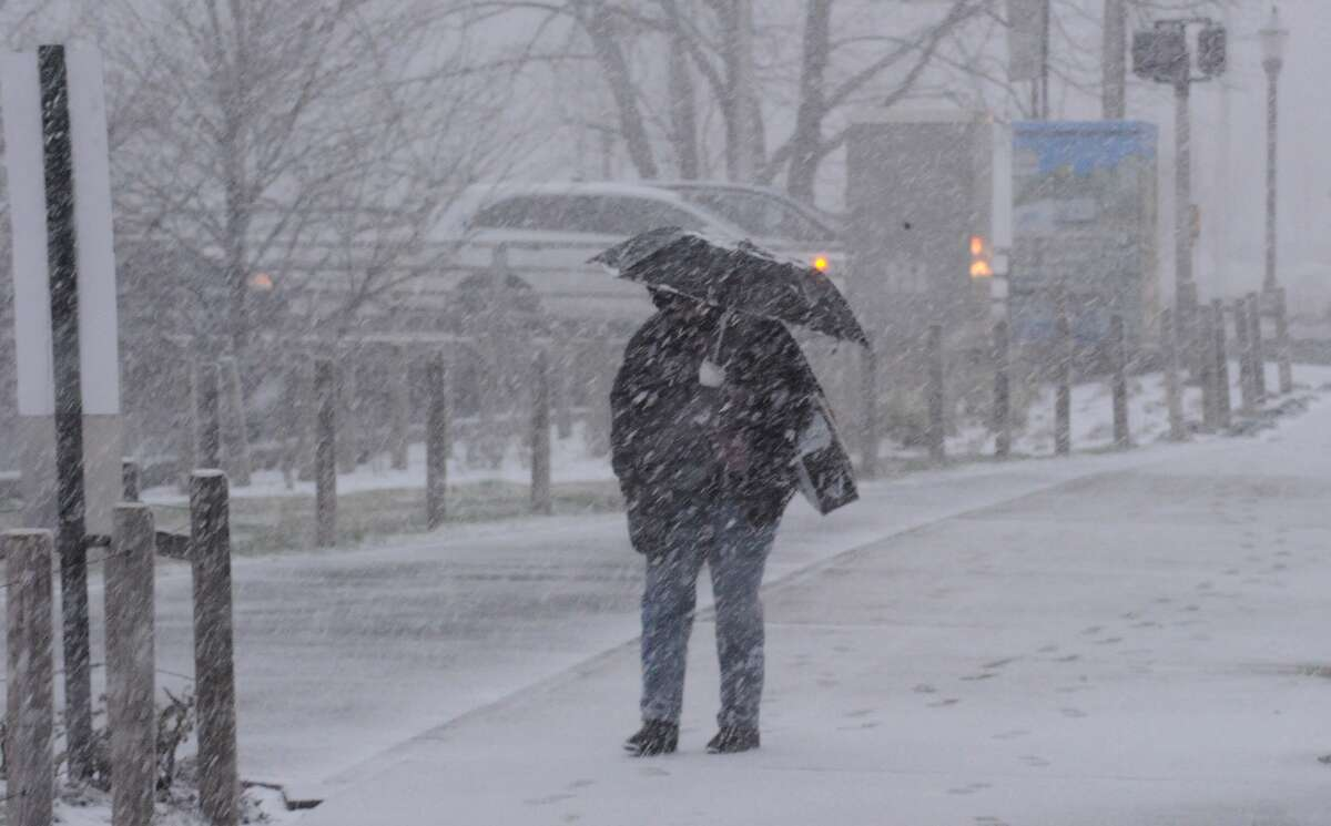 A pedestrian makes there way down Washington Blvd through a winter snow squall in Stamford. Photo by Matt Brown