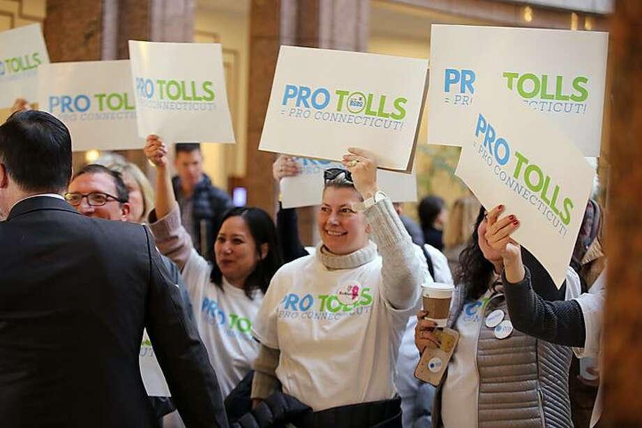 Pro-toll protesters greet Attorney General William Tong at the Legislative Office Building on Wednesday. Photo: Christine Stuart / CTNewsJunkie.com