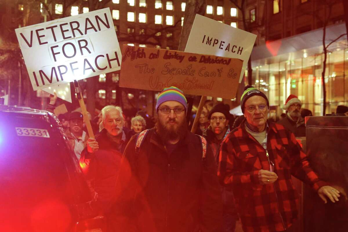 Hundreds gathered for a rally calling for the impeachment of President Donald Trump at the Federal Building in downtown Seattle, joining a national day of protest on the eve of the House of Representatives impeachment vote, Tuesday, Dec. 17, 2019. Seattle Mayor Jenny Durkan and King County Executive Dow Constantine spoke at the event.