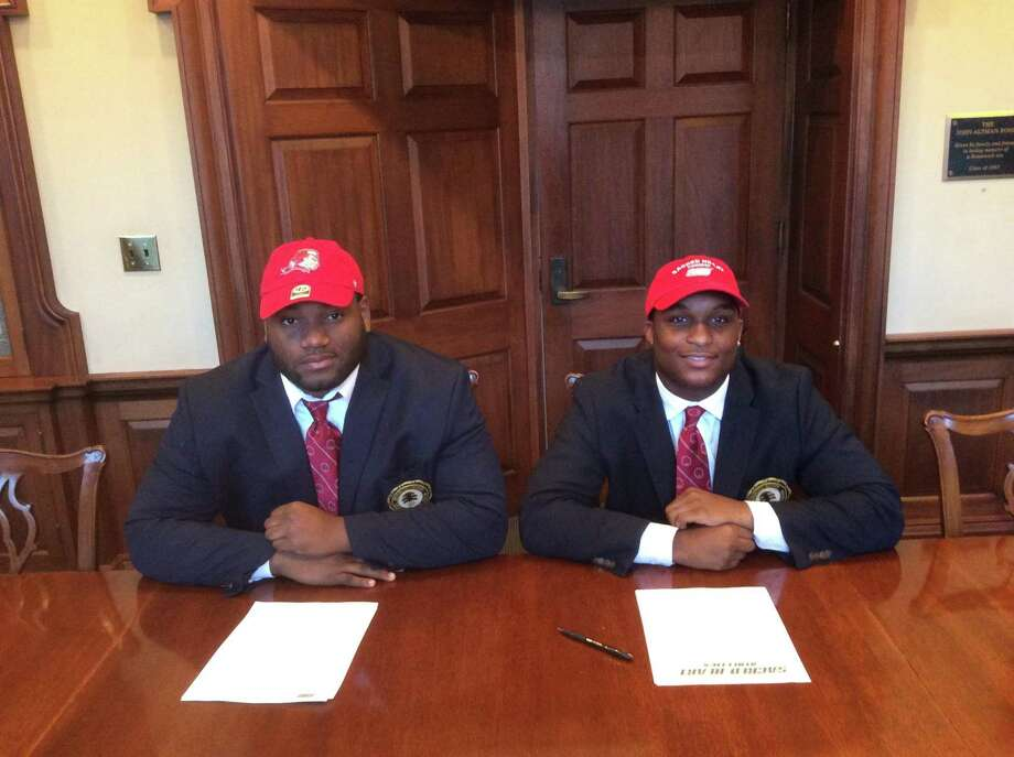 Howard Powell, left, and Jalen Madison each signed National Letters of Intent to play football at Sacred Heart University. Photo: David Fierro /Hearst Connecticut Media