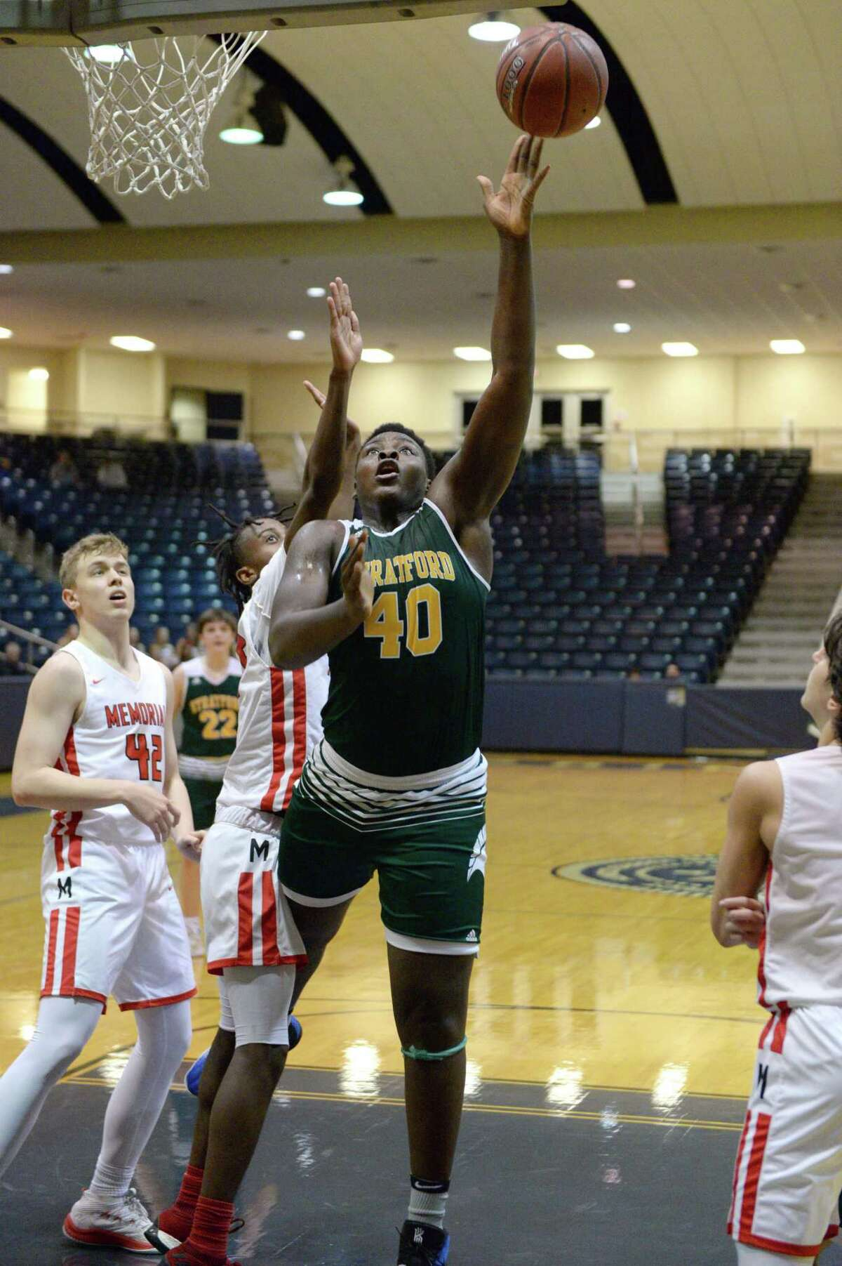 Hector Igbikiowubo (40) of Stratford attempts a lay-up during the second half of a 6A Region III District 17 Boys basketball game between the Memorial Mustangs and the Stratford Spartans on Tuesday, December 17, 2019 at Coleman Coliseum, Houston, TX.