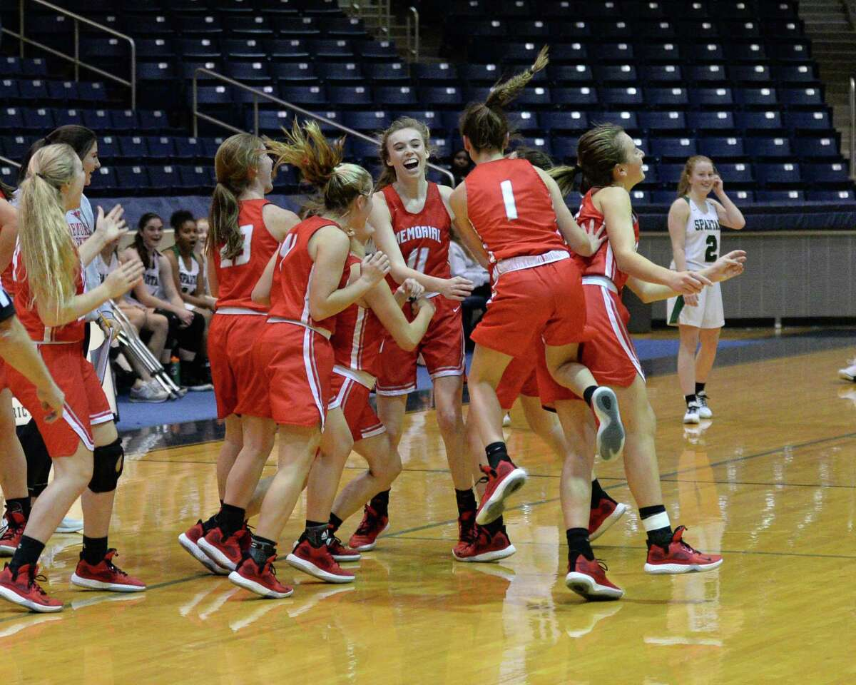 The Mustangs celebrate a buzzer beating long-range shot by Morgan Matheny (5) of Memorial at the end of the first half of a 6A Region III District 17 Girls basketball game between the Memorial Mustangs and the Stratford Spartans on Tuesday, December 17, 2019 at Coleman Coliseum, Houston, TX.