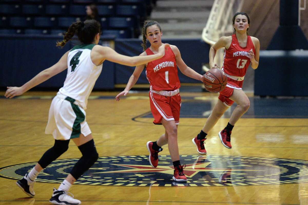 Riley McCloskey (1) of Memorial dribble s past mid-court during the first half of a 6A Region III District 17 Girls basketball game between the Memorial Mustangs and the Stratford Spartans on Tuesday, December 17, 2019 at Coleman Coliseum, Houston, TX.