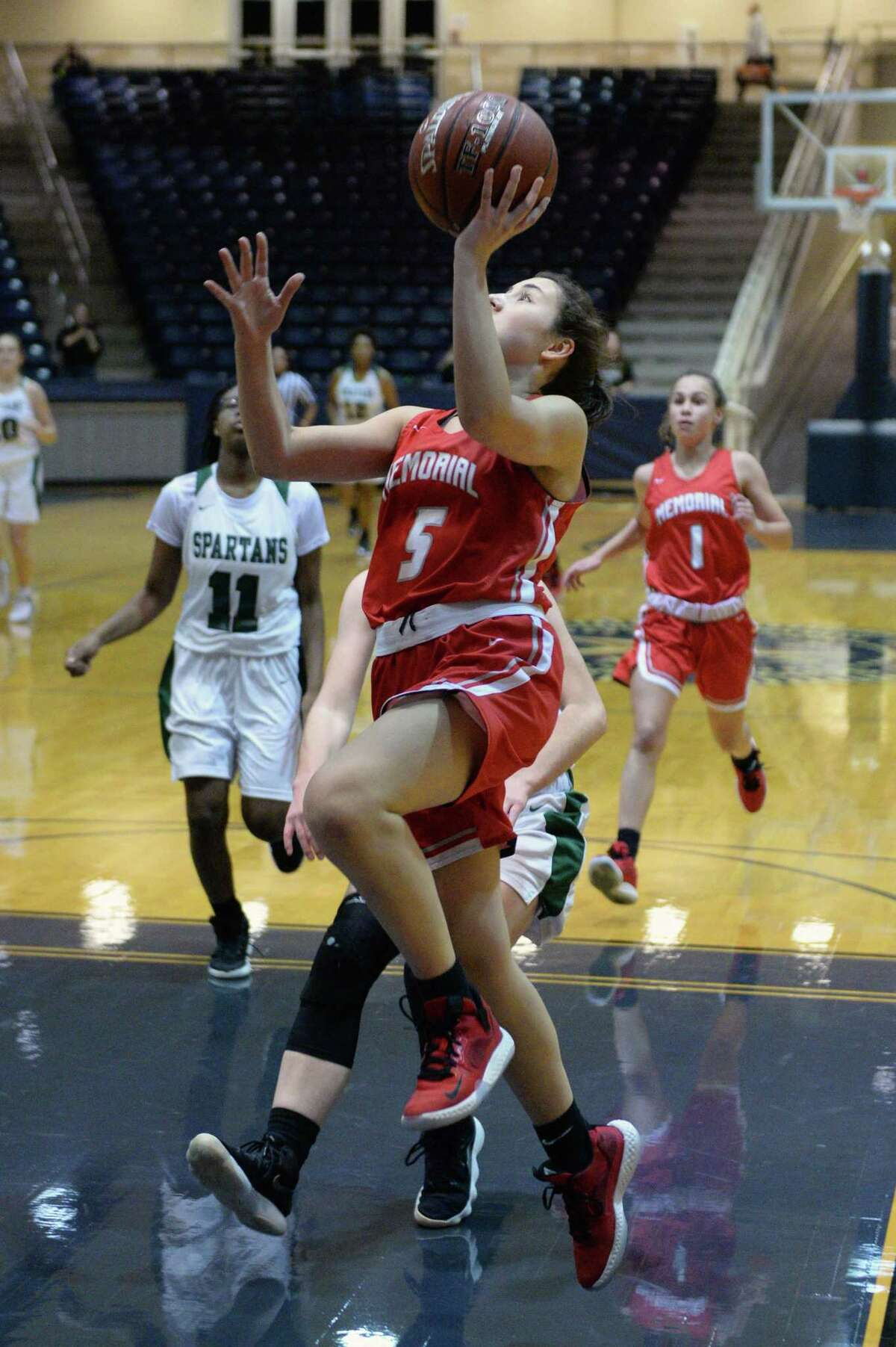 Morgan Matheny (5) of Memorial drives to the basket during the first half of a 6A Region III District 17 Girls basketball game between the Memorial Mustangs and the Stratford Spartans on Tuesday, December 17, 2019 at Coleman Coliseum, Houston, TX.