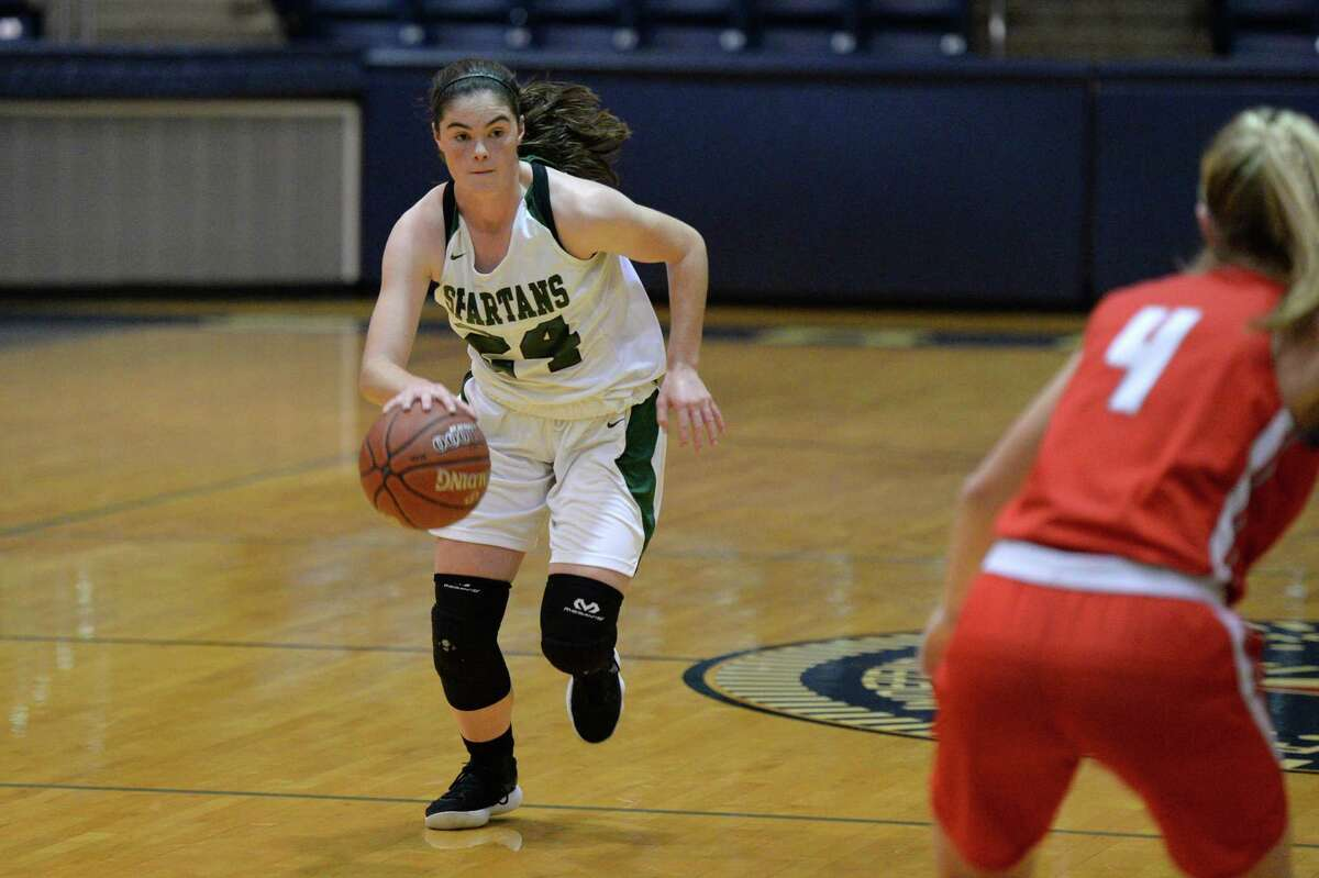 Caroline Parnell (24) of Stratford dribbles past mid-court during the first half of a 6A Region III District 17 Girls basketball game between the Memorial Mustangs and the Stratford Spartans on Tuesday, December 17, 2019 at Coleman Coliseum, Houston, TX.