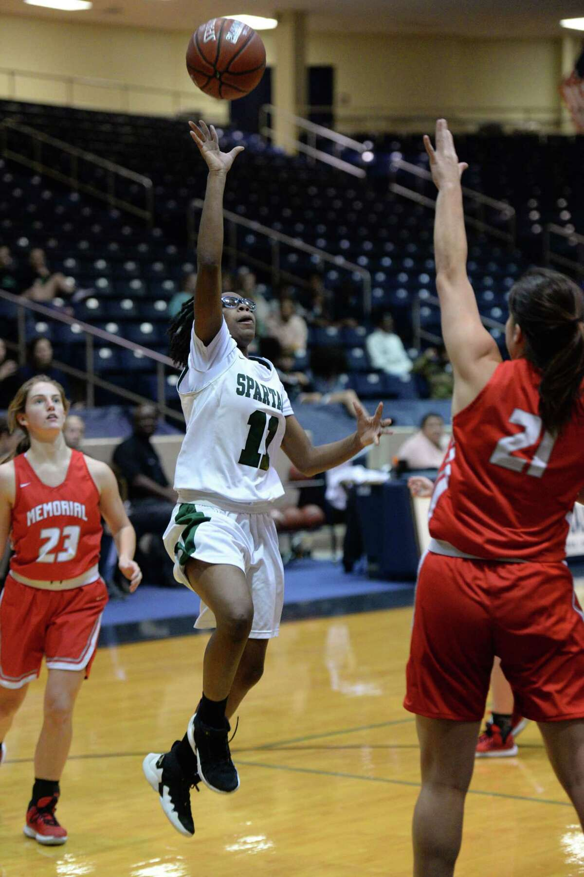 Jakyla Cheeves (11) of Stratford attempts a shot during the first half of a 6A Region III District 17 Girls basketball game between the Memorial Mustangs and the Stratford Spartans on Tuesday, December 17, 2019 at Coleman Coliseum, Houston, TX.