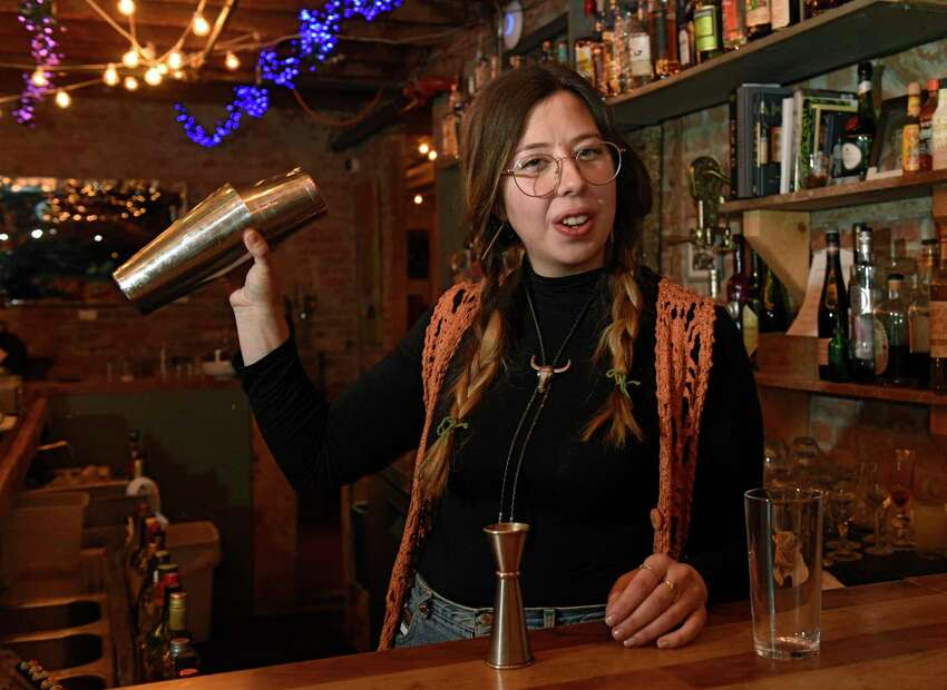 Bartender Tiffany Myers makes a Thyme kombucha cooler mocktail at the Tavern Bar which is located on the second floor of Peck's Arcade on Thursday, Dec. 12, 2019 in Troy, N.Y. The recipe is 1/2 oz simple syrup, 3/4 oz lemon juice, 3/4 oz. apple juice, 3 oz Yesfolk Crystal Falls kombucha, sparkling water, 3 sprigs of thyme. (Lori Van Buren/Times Union)