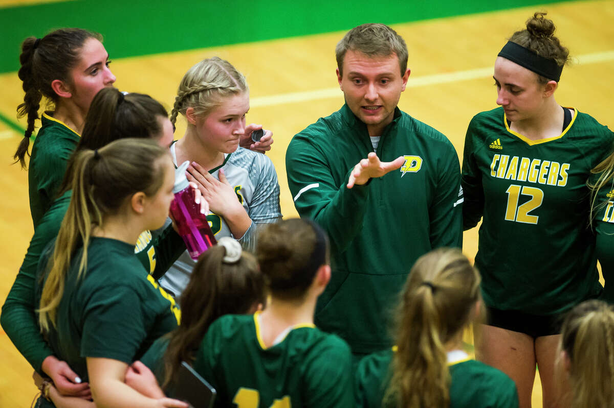 Dow High volleyball coach C.J. Blaha talks with his team during an Oct. 11, 2018 match against Clio.