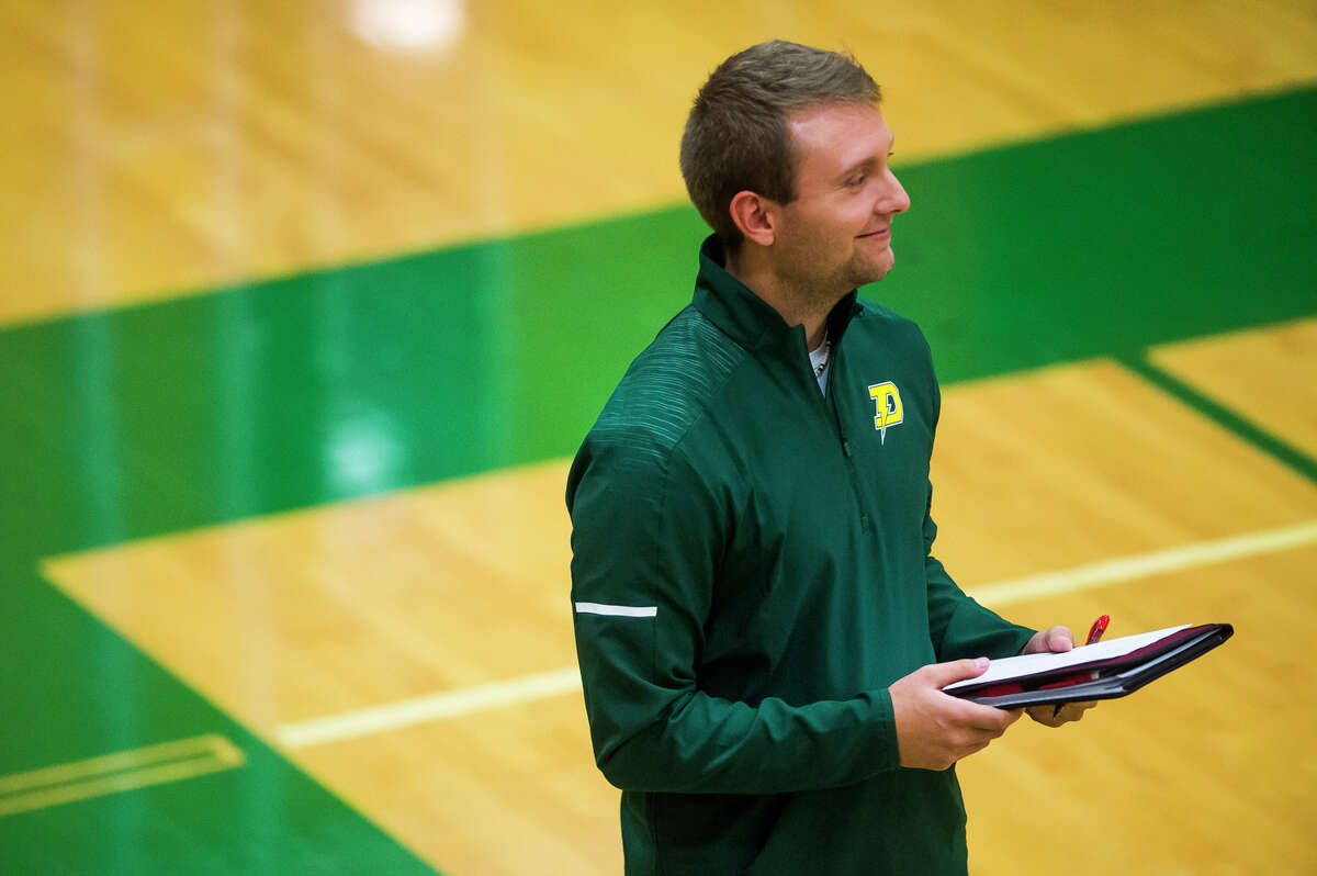 Dow High volleyball coach C.J. Blaha watches his team in action during an Oct. 11, 2018 match against Clio.