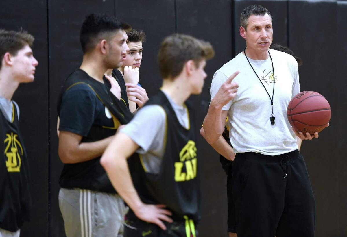 Law coach Jamie Anderson speaks to the team during practice in Milford on Friday.