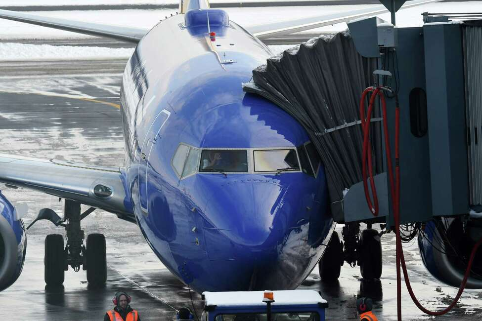 A Southwest Boeing 737-7H4 passenger jet waits to push back from the gate at Albany International Airport on Wednesday, Dec. 18, 2019, in Colonie, N.Y. (Will Waldron/Times Union)