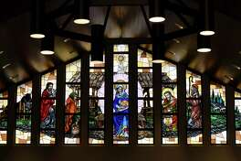 The birth of Christ is depicted over massive stained glass panels at St. Peter's Armenian Church on Wednesday, Dec. 18, 2019, in Watervliet, N.Y. (Will Waldron/Times Union)