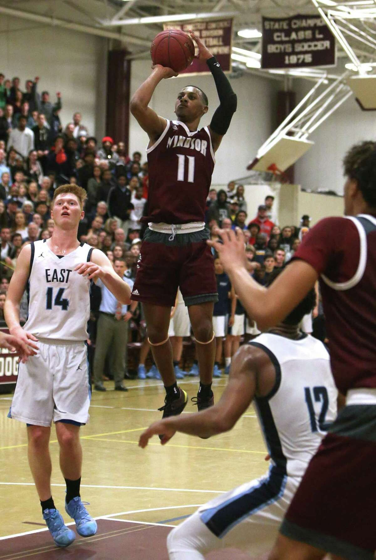 Windsor's Amir Spears goes up for a shot during the Central Connecticut Conference tournament final against East Catholic on Feb. 28. Windsor won 87-85.