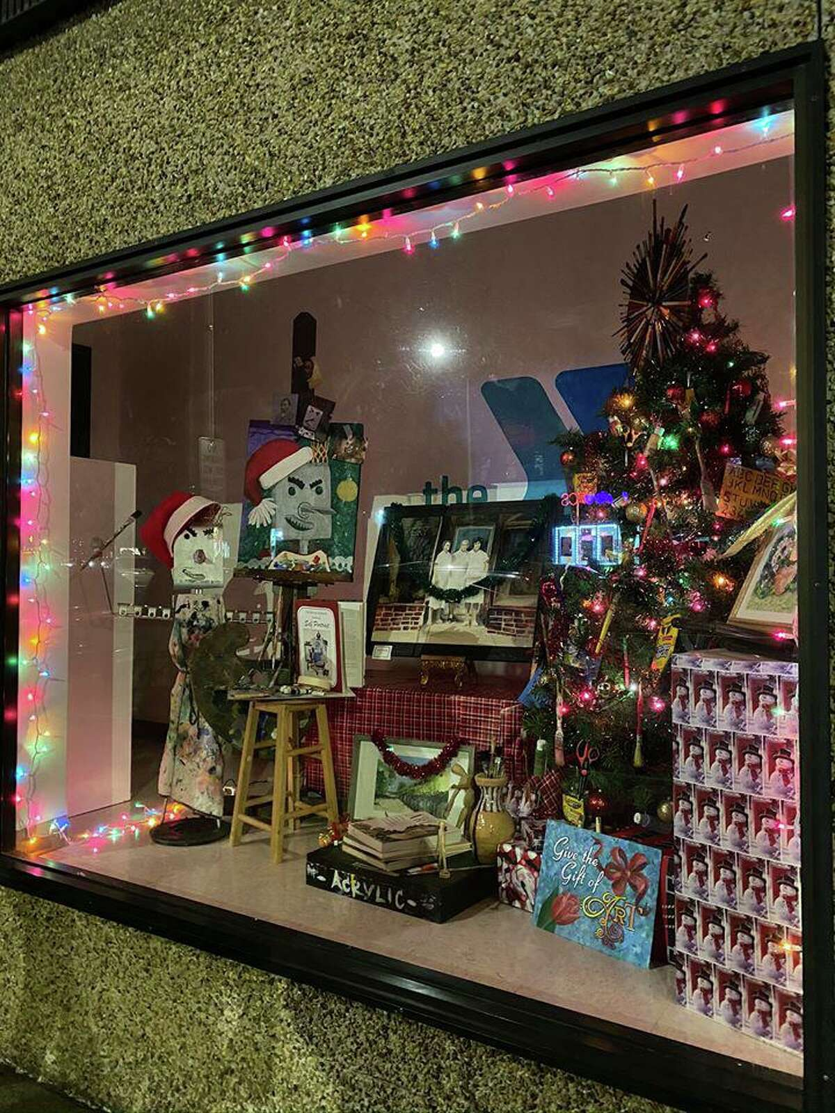 This storefront for the Regional YMCA's Escape to the Arts won the Best Overall award in the annual downtown Danbury holiday decorating contest sponsored by CityCenter Danbury.