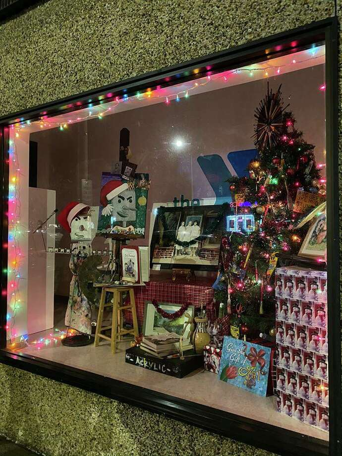 This storefront for the Regional YMCA's Escape to the Arts won the Best Overall award in the annual downtown Danbury holiday decorating contest sponsored by CityCenter Danbury. Photo: Renato Ghio /