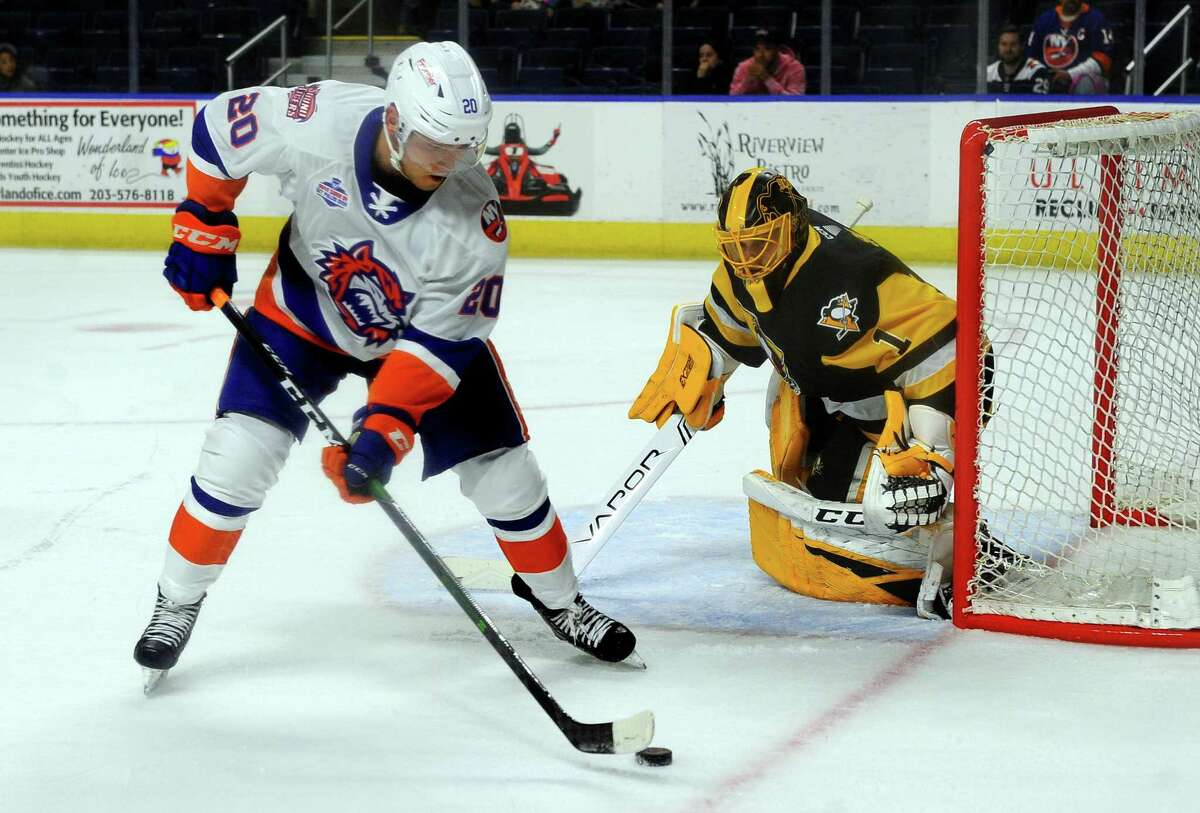 The Sound Tigers' Kieffer Bellows (20) gets the puck near the W-B/Scranton goalie Casey DeSmith at the Webster Bank Arena in Bridgeport last season.