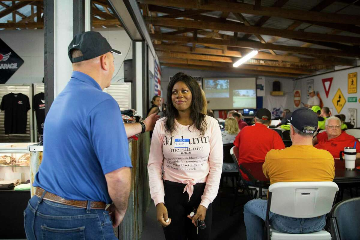 Patrice Harris is greeted by supporters after receiving the keys to her car at the new God's Garage location on Saturday, Dec. 7, 2019, in Conroe, TX.