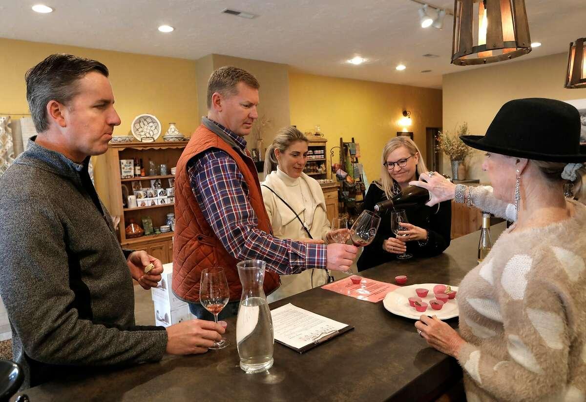 Will Sammon (from left), Brandon Hannaman, Kim Sammon and Heidi Hannaman sample wines at the Terre Rogue/Easton tasting room in Plymouth, Ca., on Sun. Feb. 17, 2019.