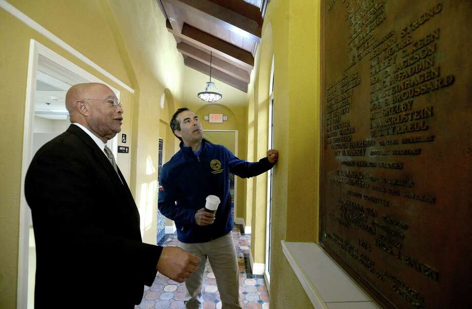 Texas General Land Office (GLO) Commissioner George P. Bush and developer Josh Allen look over the original dedication plaque while on a tour during a re-opening ceremony at the Beaumont Senior Citizen Y House Wednesday. The historic senior apartment complex has been closed following damage sustained during Tropical Storm Harvey, and is now open following renovations made possible by $3.7 million dollar funds provided by GLO. Photo taken Wednesday, December 18, 2019 Kim Brent/The Enterprise Photo: Kim Brent / The Enterprise / BEN